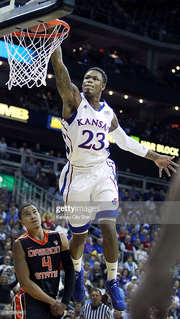 After picking up a loose ball and driving the length of the floor, Kansas' Ben McLemore soars above Oregon State's Challe Barton for a dunk during the first half at the Sprint Center in Kansas City, Missorui, on Friday, November 30, 2012. Kansas held off Oregon State, 84-78.