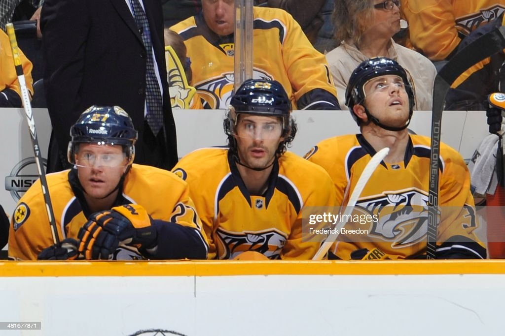 After playing 387 minor league games thirty-year old Mark Van Guilder #29 of the Nashville Predators watches from the bench during his first career NHL game against the Washington Capitals at Bridgestone Arena on March 30, 2014 in Nashville, Tennessee.