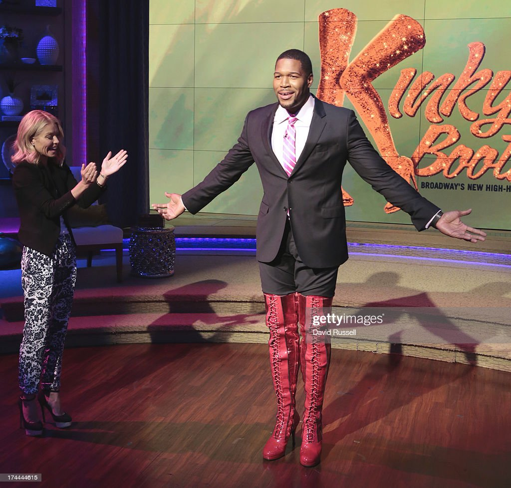 MICHAEL -7/25/13 - After recapping his return to Broadway in the Tony Award-winning musical 'Kinky Boots,' host Michael Strahan modeled his own custom pair of kinky boots for the audience on 'LIVE with Kelly and Michael,' distributed by Disney-ABC Domestic Television. KELLY