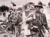 After receiving a fresh supply of ammunition and water flown in by helicopter men of the US 173rd Airborne Brigade continue on a jungle 'Search and...