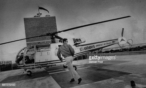 After receiving information on accident Reich a former US military pilot dashes to the helicopter to fly to the scene of the mishap Credit Denver Post