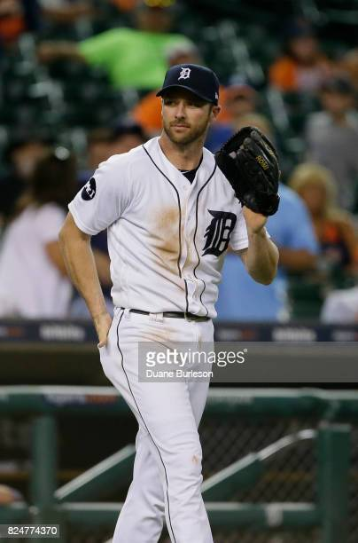After retrieving his standard fielders glove Andrew Romine of the Detroit Tigers returns to the field to pitch against the Kansas City Royals after...