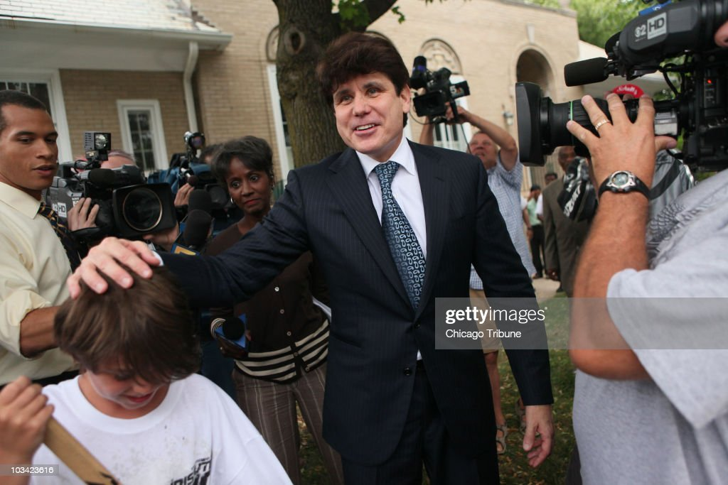 After returning to his Chicago, Illinois home, former Illinois Gov. Rod Blagojevich pats the head of a neighborhood boy, Tuesday, August 17, 2010. A federal jury convicted Blagojevich of just one count -- lying to the FBI -- and deadlocked on 23 other counts.