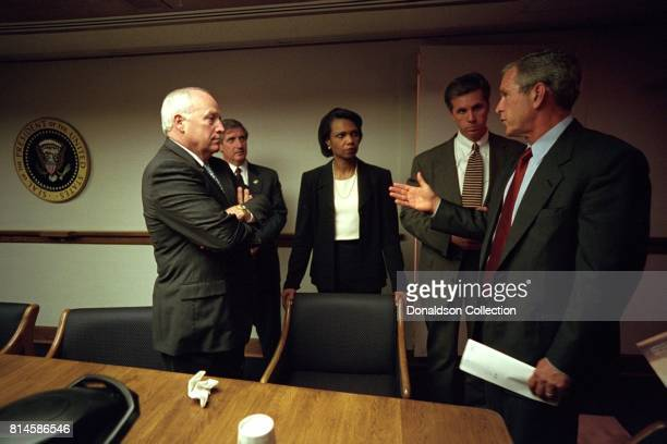 After returning to the White House President George W Bush meets with from left Vice President Dick Cheney Chief of Staff Andy Card Condoleezza Rice...