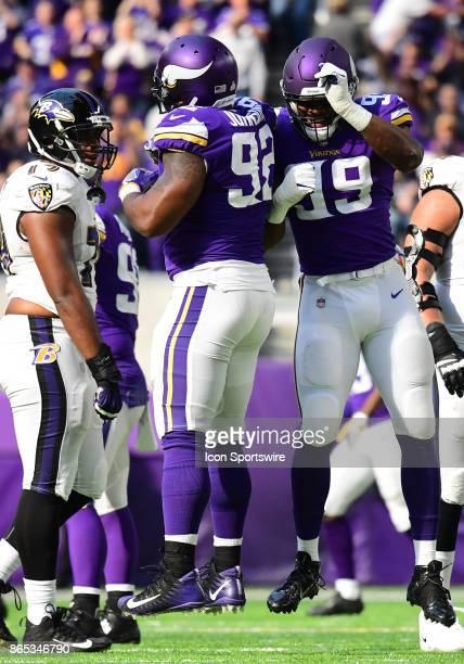 After sacking Baltimore Ravens quarterback Joe Flacco Minnesota Vikings defensive tackle Tom Johnson celebrates with Minnesota Vikings defensive end...