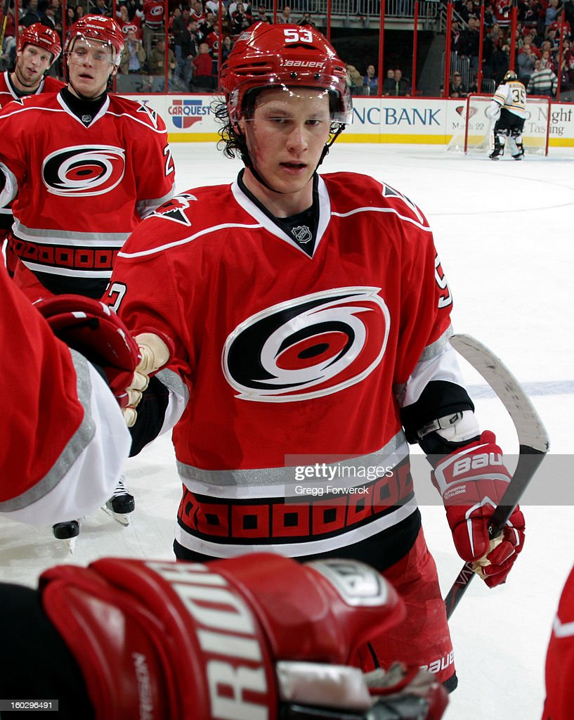After scoring his second-period goal, Jeff Skinner #53 of the Carolina Hurricanes is congratulated by teammates at the Hurricanes bench during their NHL game against the Boston Bruins on January 28, 2013 at PNC Arena in Raleigh North Carolina.