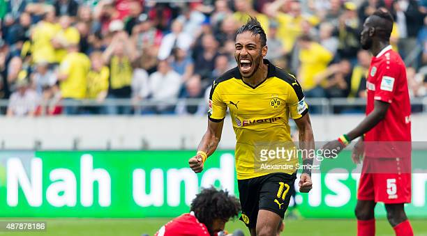 After scoring the 23 PierreEmerick Aubameyang of Borussia Dortmund celebrates during the Bundesliga match betweenÊHanover 96 v Borussia Dortmund at...
