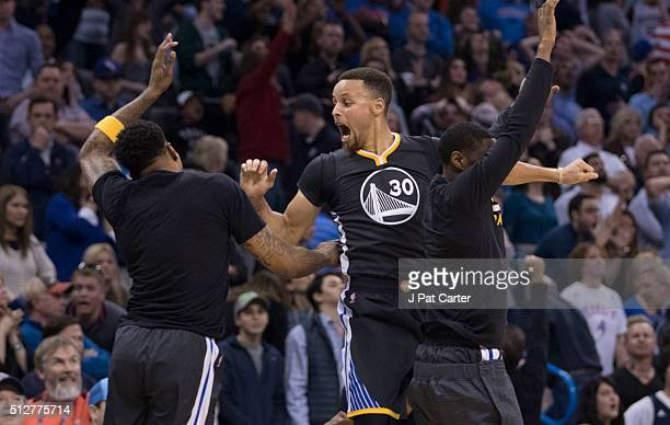 After scoring the winning threepoint shot Stephen Curry of the Golden State Warriors celebrates during the overtime period of a NBA game against the...
