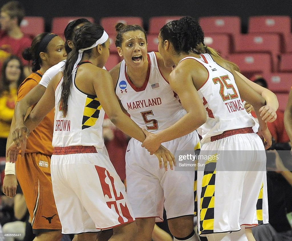 After scoring while being fouled, Maryland Terrapins center Malina Howard (5) rallies guard Lexie Brown (4) and forward Alyssa Thomas (25) during the second round of the NCAA Tournament in College Park, Md., on Tuesday, March 25, 2014.