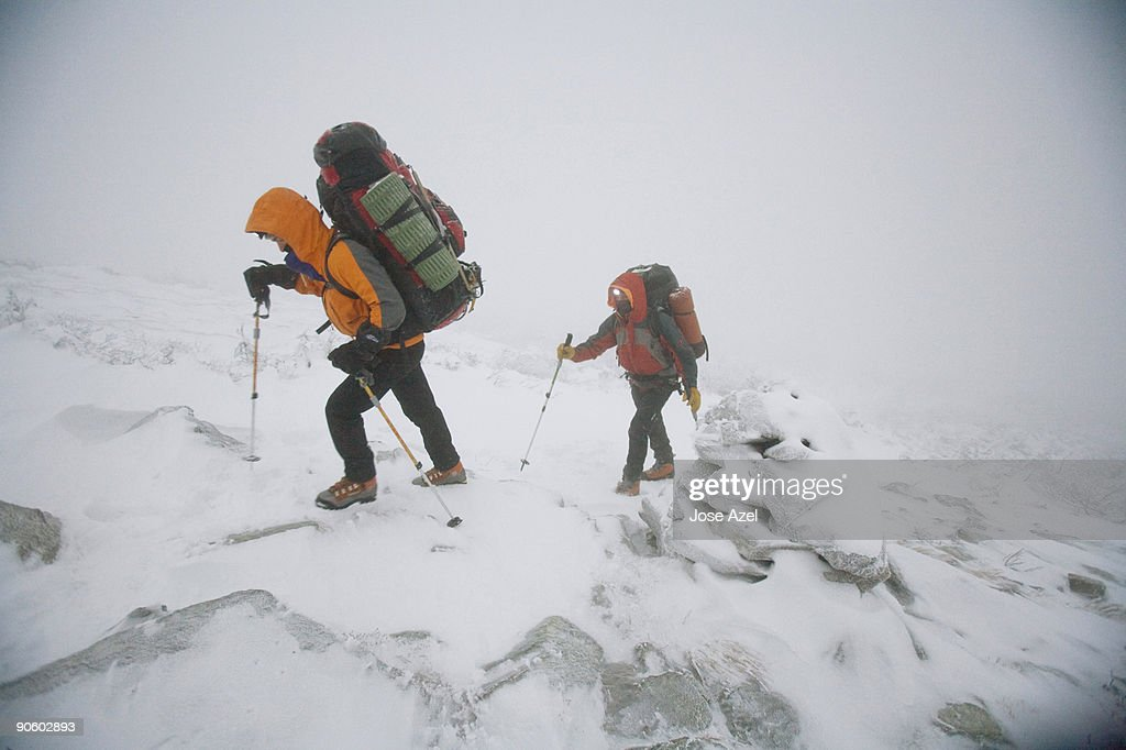 After setting out at dawn from a Cabin at the North end of the Presidential Range, two hikers head t