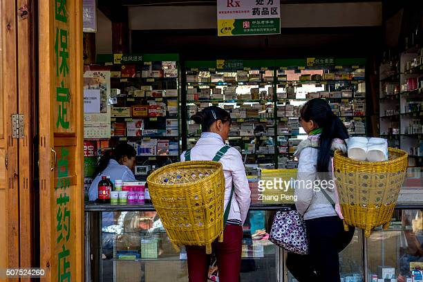 After shopping two local women go to a pharmacy Friday bazaar in Shaxi ancient town is a local custom maintained for centuries Shaxi located half way...