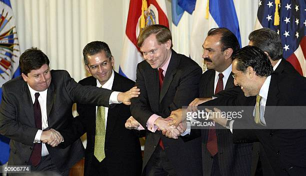 After signing the Central American Free Trade Agreement the trade representatives from all six participating countries shake hands 28 May 2004 at the...