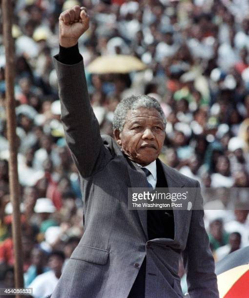 FILE After spending 27 years in prison Nelson Mandela returns home to Soweto and salutes the over 100000 supporters jammed into a soccer stadium in...