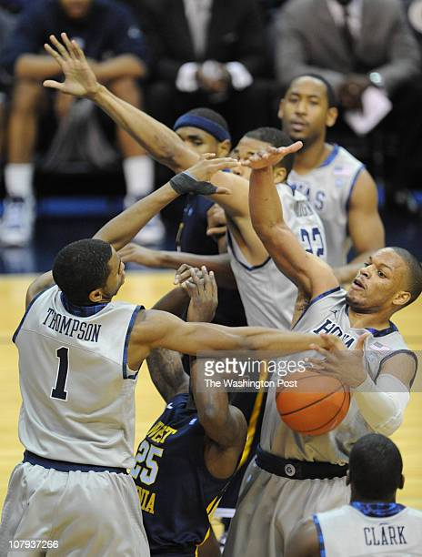After stripping the ball from West Virginia Mountaineers guard Darryl Bryant Georgetown Hoyas forward Hollis Thompson left and Georgetown Hoyas guard...