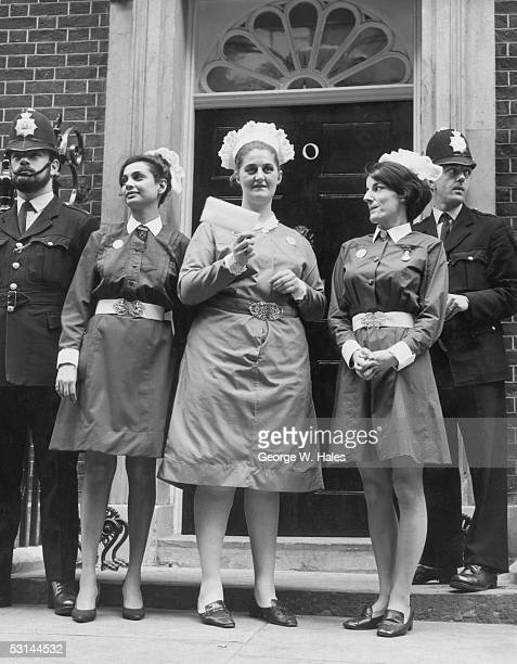 After taking part in a nurses' protest march from Speakers' Corner to Downing Street Mary Chundee Pat Veal and Tina Stone prepare to hand in a...