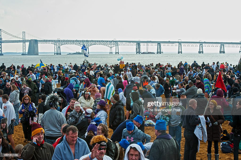 After taking part in the 17th Annual MSP Polar Bear Plunge people rush to cover up or change into dry clothes on Saturday, January 26, 2013.