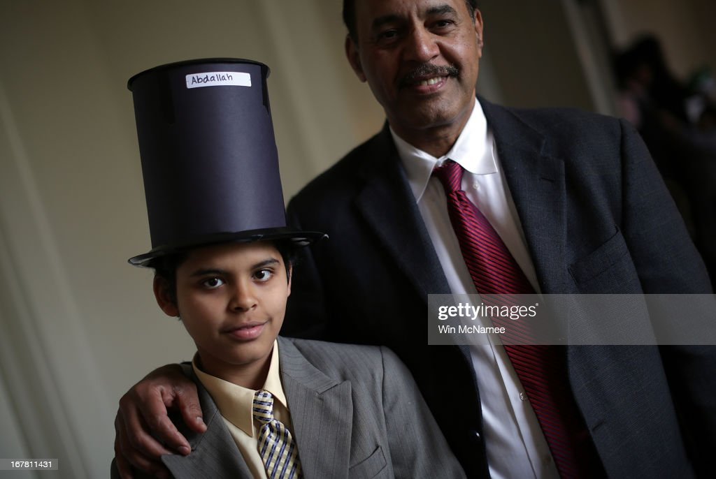 After taking the Oath of Allegiance and becoming a U.S. citizens, Abdallah Solimen poses for a photo with his father Ahmed Solimen (R) following a naturalization ceremony for twenty children in the Emancipation Room at President Lincoln's Cottage April 30, 2013 in Washington, DC. The special citizenship ceremony was hosted by the U.S. Citizen and Immigration Services at the seasonal residence the Lincoln family used during the Civil War and the site where President Lincoln developed the Emancipation Proclamation.