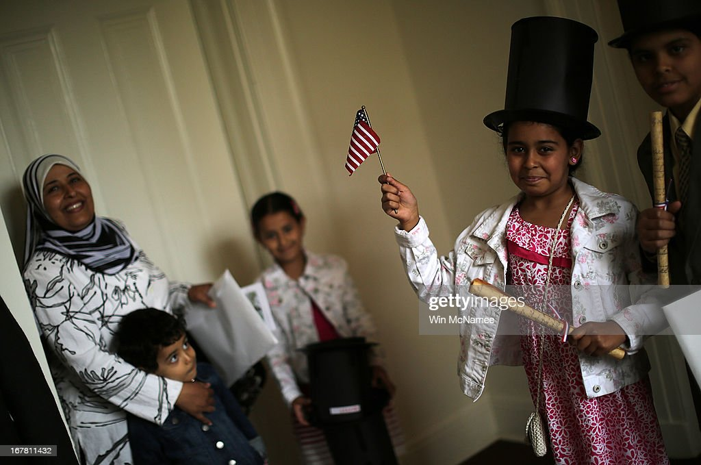 After taking the Oath of Allegiance and becoming U.S. citizens, Abdallah Solimen (R) and Nouran Solimen (2nd R) pose for a photo for their father following a naturalization ceremony for twenty children in the Emancipation Room at President Lincoln's Cottage April 30, 2013 in Washington, DC. The special citizenship ceremony was hosted by the U.S. Citizen and Immigration Services at the seasonal residence the Lincoln family used during the Civil War and the site where President Lincoln developed the Emancipation Proclamation. From (L-R) are Amany Solimen, Yosef Solimen, Sarah Solimen, Nouran Solimen, and Abdallah Solimen.