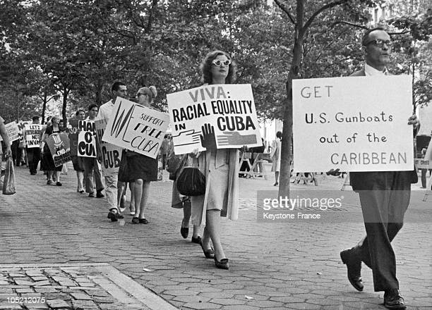 After The American And Anticastrist Intervention In The Bay Of Pigs On April 20 A Group Of Demonstrators Members Of The Fair Play Commitee Struggling...