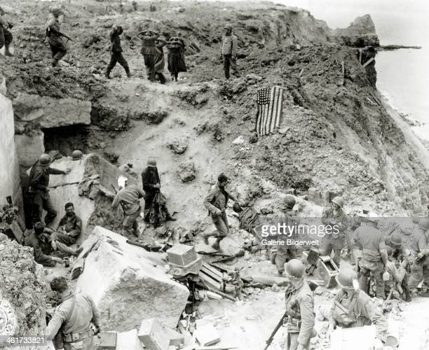 After the assault at the cliffs of Pointe du Hoc by the 2nd Ranger Battalion Colonel James E Rudder establishes a Post Commando June 1944 German...