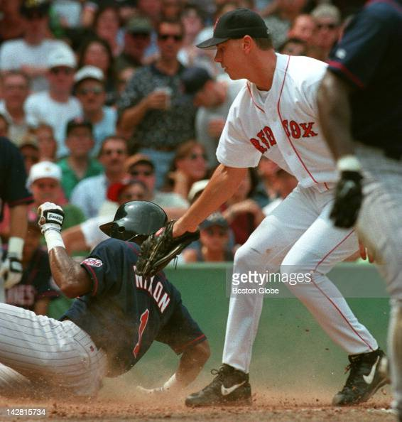 After the ball gets away from Red Sox catcher Jason Varitek the Twins ...