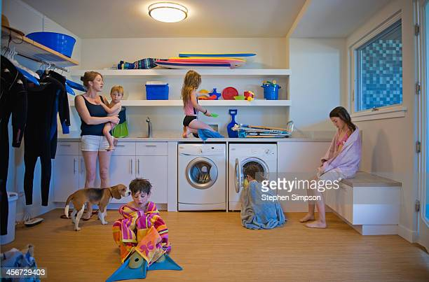 after the beach, family scattered in laundry room