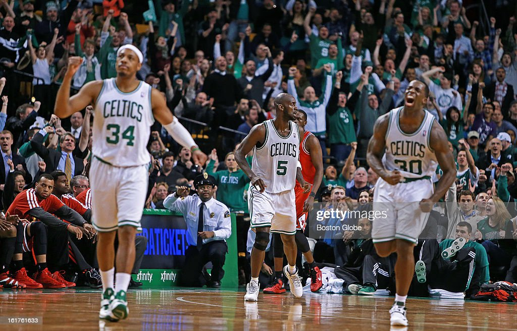 After the Celtics' Kevin Garnett (#5), center, hit a shot that put Boston ahead 69-66 with less than 20 seconds left in the game, he got reactions from teammate Paul Pierce (#34), left, Brandon Bass (#30), right, and the crowd, but none from the Chicago bench, lower left. The Boston Celtics hosted the Chicago Bulls in an NBA regular season basketball game at the TD Garden.