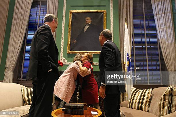 After the exchange of the traditional symbols Governorelect Charlie Baker and outgoing Governor Deval Patrick watch as their wives Lauren Baker and...