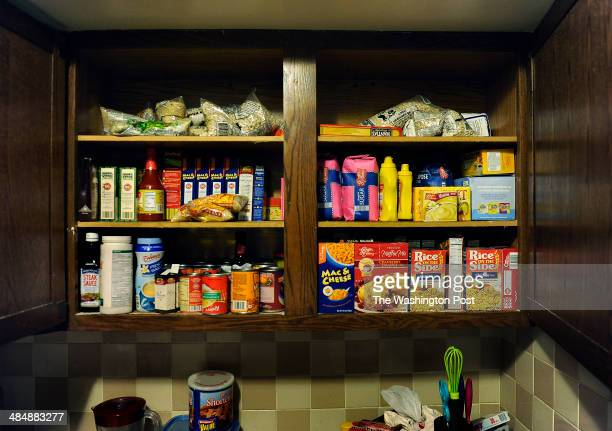 After the first major food shopping trip that had been taken in a month the cupboards at the home of Raphael Richmond are well stocked with food...