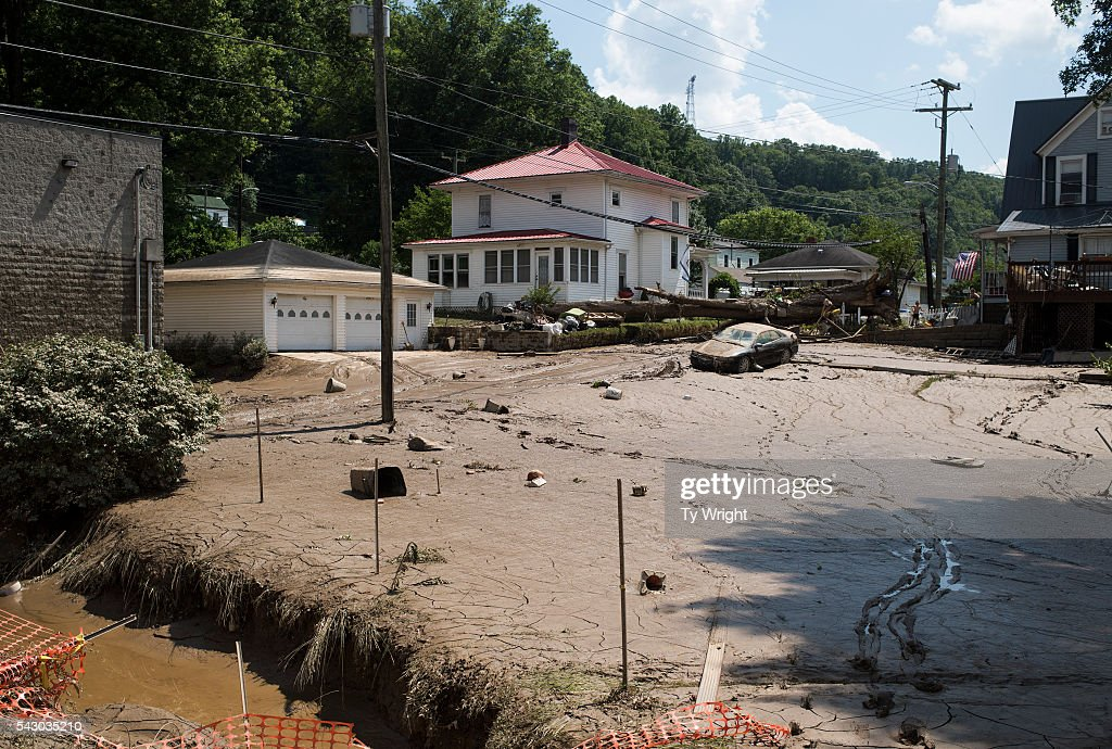 After the flood waters receded, mud covers a street intersection on June 25, 2016 in Clendenin, West Virginia. The flooding of the Elk River claimed the lives of at least 23 people in West Virginia.