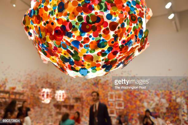 After the last wave of visitors to the Obliteration Room on the final day of the Yayoi Kusama Infinity Mirrors exhibit museum staff mingle among the...