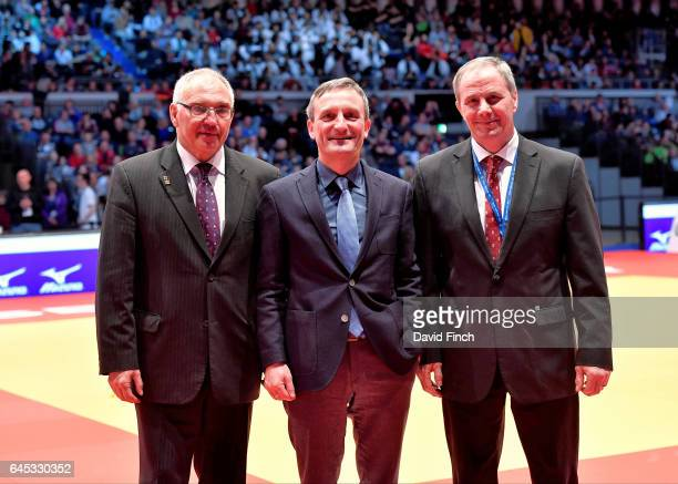 After the Opening Ceremony the three speakers posed for the photographers with Peter Frese President of the German Judo Federation the Mayor of...
