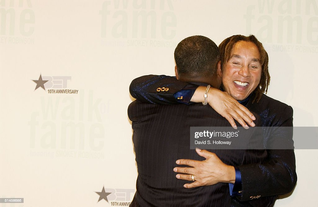 After the performance singer Smokey Robinson hugs his friend Donnie Simpson, the host of Black Entertainment Television's 10th Anniversary Walk of Fame celebration honoring Smokey Robinson on October 9, 2004 in Washington, DC.