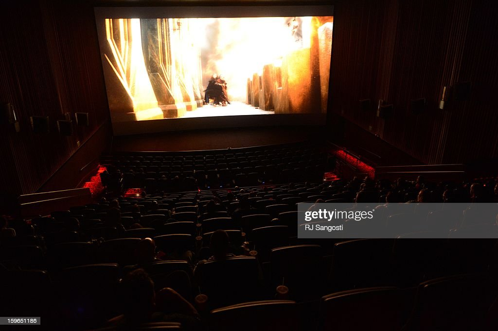 After the reopening and remembrance in Theater I XD of the Century Aurora Theater guests stay for special viewing of the Hobbit. James Holmes is accused of killing 12 people and wounding 70 others on July 20, 2012 in theater 9.