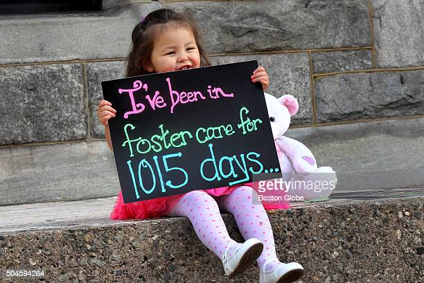 After the Rubio family formally adopted Alexandra they pose her with a series of signs outside the courthouse The first read Ive been in foster care...