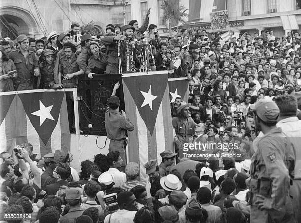 After the success of his revolution Fidel Castro surrounded by his closest associates speaks to huge crowds in Havana Cuba in December of 1959