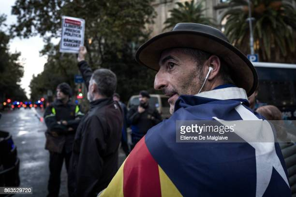 After the ultimatum deadline from Spanish government against separatist Catalans expired protesters gather outside the building that houses the...