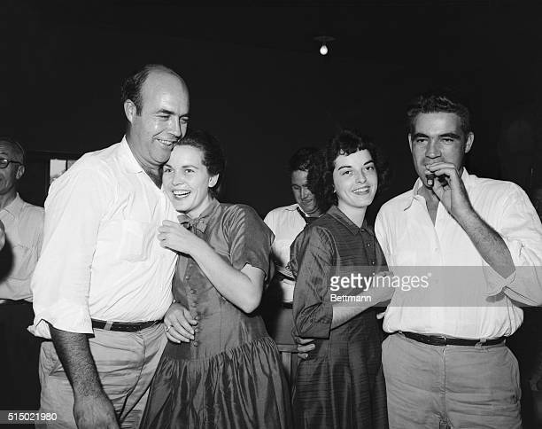 After their acquittal in the Emmett Till trial defendant Roy Bryant smokes a cigar as his wife happily embraces him His half brother JW Milam and his...
