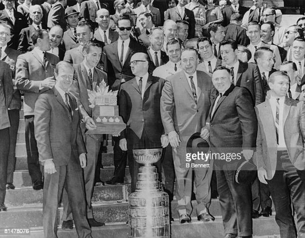 After their Stanley Cup victory and upon their return home the Montreal Canadiens ice hockey team show off their trophy on the steps of City Hall...