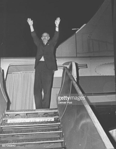 After two and a half hours in Denver President Johnson raises both hands in farewell as he boards his plane for the trip to Boise Idaho Credit Denver...