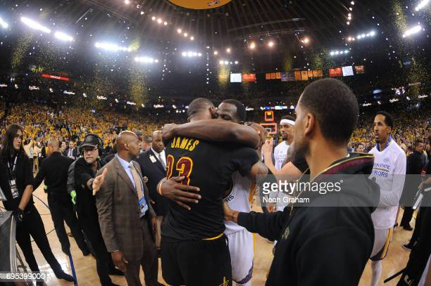 LeBron James of the Cleveland Cavaliers and Draymond Green of the Golden State Warriors embrace after Game Five of the 2017 NBA Finals on June 12...