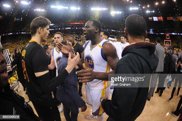 Kyle Korver of the Cleveland Cavaliers gives five to Draymond Green of the Golden State Warriors after Game Five of the 2017 NBA Finals on June 12...