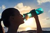 Woman drinking water after her workout.