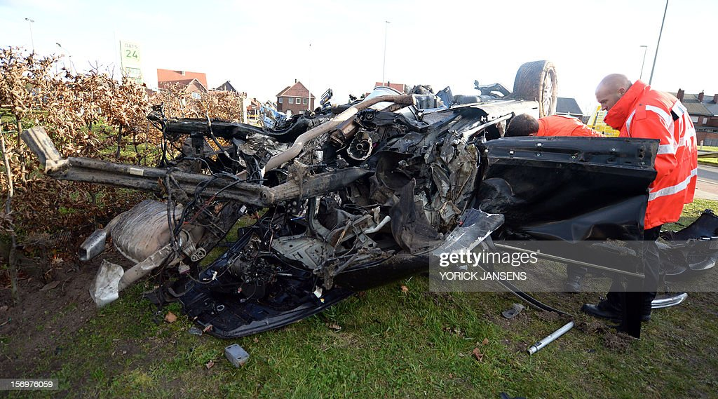 Aftermath of an accident with three cars at the Rode Kruislaan in Bree, on November 25, 2012. One person died in the accident, two were seriously injured.AFP PHOTO YORICK JANSENS