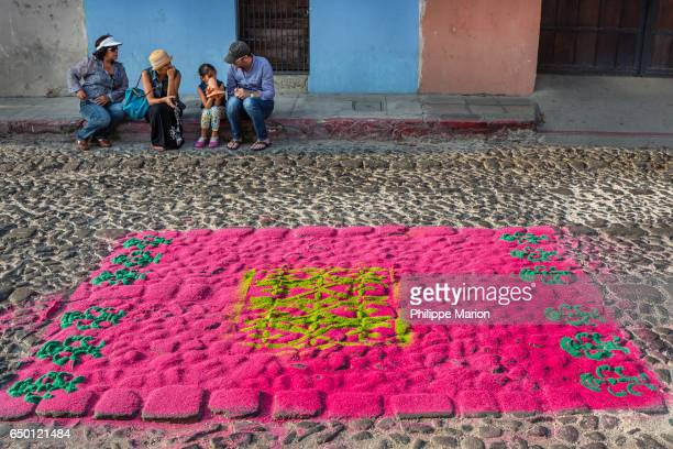 Aftermath of colorful street carpet (alfombra) after being trampled by religious procession during Semana Santa, in Antigua, Guatemala