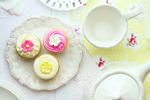 Tea and cupcakes, overhead view