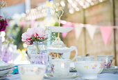 Close up image of a tea party set up in the summer time