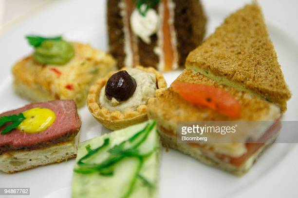 Afternoon tea sandwiches are arranged for a photograph in the Palm Court at the Plaza Hotel in New York US on Monday March 17 2008 Recession What...