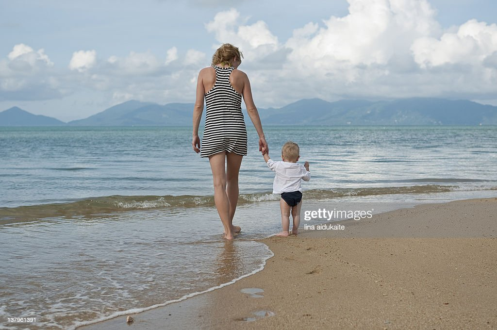 Afternoon walk on beach : Stock Photo