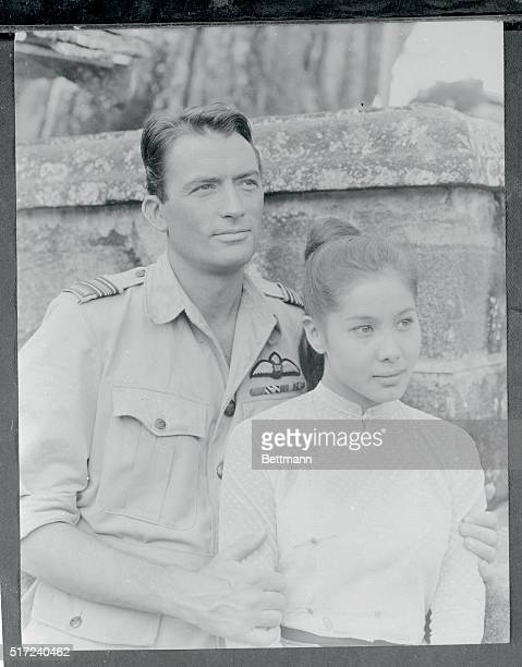 Against a background of Ceylon hills and jungles Gregory Peck American actor and Win Min Than lovely Burmese actress complete a scene from the...